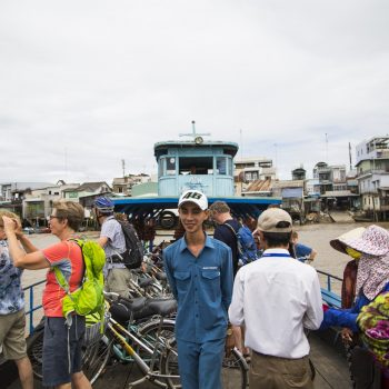 Mekong ferry boarded with both locals and tourists departing mekong city