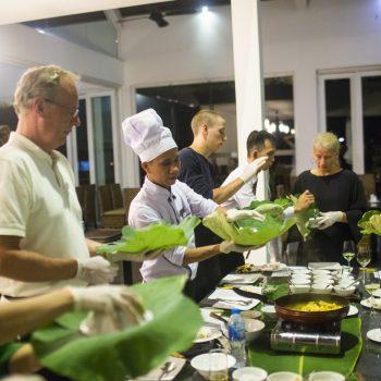 Tourist enjoying traditional Vietnamese cooking class in Hanoi