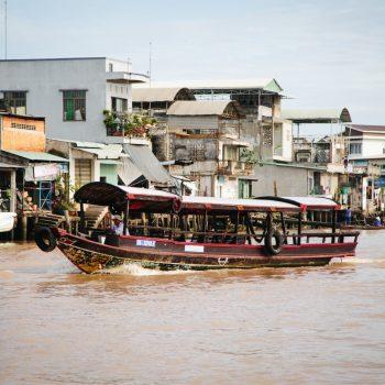 Classic mekong river boat sailing