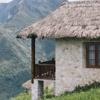 Rustic bungalow Topas Ecolodge in front of the Sapa mountains