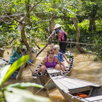 People Sailing through mekong river jungle
