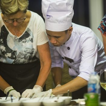 Local vietnamese cook shows tourist how to make delicious Vietnamese food