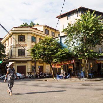Traditional vietnamese walking the Hanoi Old quarter