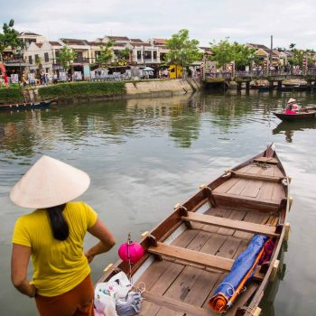 Local vietnamese on boat in Hoi An