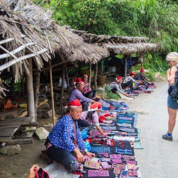 Local minority market where Red Dao tribe women sell their handicraft
