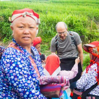 Tourist buying local handcraft from Red Zao minority women