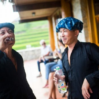 Local villagers visiting Topas Ecolodge and enjoy a glass of rice wine