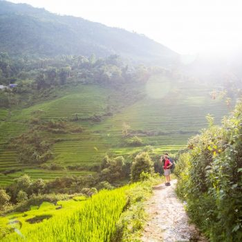 Hiking turist on the stunning hiking trails in Sapa mountains