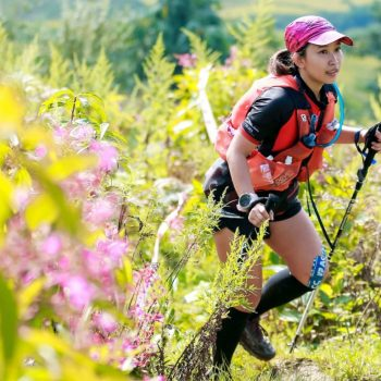 Trail runner, running through beautiful flower nature in Vietnam Mountain marathon
